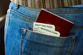 Passport and air boarding passes in jeans pocket