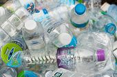 Pathumthani, Thailand - 2014: Clear Plastic Bottles Lie In A Bin In Junk Shop Waiting To Be Recycled