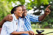cheerful afro american couple relaxing outdoors