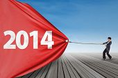 Businesswoman Pulling New Year 2014