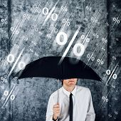 Businessman With Umbrella Protecting Himself From Percentage Rain