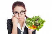 stock photo of boring  - Asian business woman bored with salad bowl isolated on white background - JPG