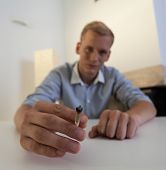 picture of blunt  - A young man holds in his hand a joint - JPG