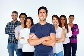 Portrait of cheerful casual people with arms folded over white background