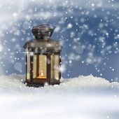 Christmas lantern on snowy background