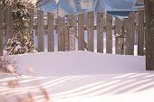 Garden gate of a suburban garden buried in snow.