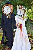 foto of scarecrow  - Creative scarecrow composition as bride and groom in a countryside garden - JPG