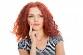 Thoughtful young woman with red hair