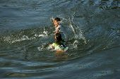 Asian Children Bath On Vietnamese River