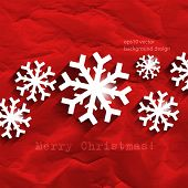 eps10 vector snowflakes on red crumpled paper Christmas winter background