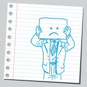 Businessman with sad face on  paper