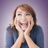 Excited happy Asian girl face, closeup portrait.
