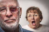 stock photo of scream  - Battered and Scared Man with Screaming Angry Woman Behind - JPG