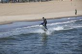 Coney Island New york  April 14:  Man on jetski jumping waves on coney Island beach April 14 2011 Co