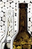 Wine bottles on corks background in vertical format
