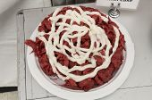 pic of red velvet cake  - Red Velvet Funnell Cake with white icing waits to be purchased from a vendor at Mumfest in New Bern North Carolina - JPG