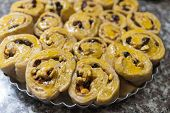 The Dough Of Cinnamon Roll With Cashew Nut And Raisin