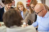 Group of business partners in casual having meeting in office