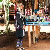 Akha Woman In Traditional Clothes Selling Souvenirs. Thailand