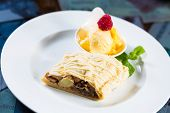 Apple strudel with icing sugar,almonds and vanilla ice cream