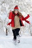 young happy woman outdoor in winter enjoying the snow