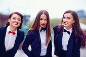 Elegant Ladies In Black Suits Outdoors