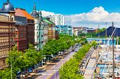 stock photo of tall ship  - Scenic summer panorama of the Old Port architecture with yachts and historical tall ships at the Old Town pier in Helsinki, Finland