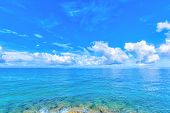 Clouds and blue ocean, tropical island