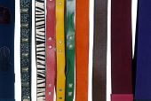 stock photo of obsidian  - Row of woman many belts - JPG