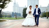 Bride and groom, on background Moscow street