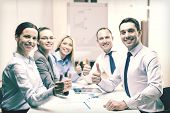 business, success, technology and office concept - smiling business team with tablet pc computer and