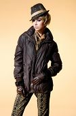 young girl in hat with jacket. Fashion photo