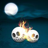 Scary burning skulls burning on night view background.