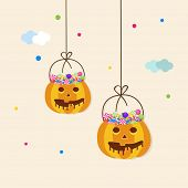 Halloween party celebration concept with hanging basket in pumpkin shape and full of lollipops.
