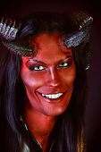 Portrait of a smiling devil with horns. Fantasy. Art project.