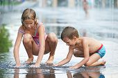 Children Playing In Puddle