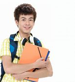 portrait of Happy smiling college student with book and bag
