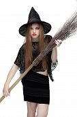 Girl in witch costume with a broom. 2