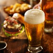foto of hamburger  - beer with hamburgers on restaurant table - JPG