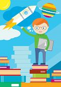 Boy with laptop in hand stands on books shows rocket