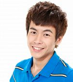 Handsome asian man smiling, isolated
