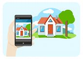 Hand holding mobile phone smartphone with house sale offer