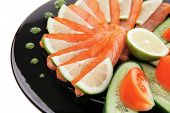 smoked salmon and vegetables served on plate