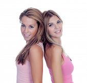 Two beautiful girl friends in pink isolated on a white background