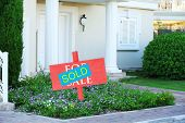 Sold home for sale real estate sign and beautiful new house