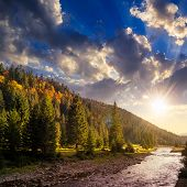 Forest River In Autumn Mountains At Sunset