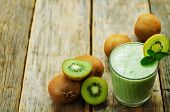 picture of carbohydrate  - smoothie kiwi in a glass on a dark wood background - JPG