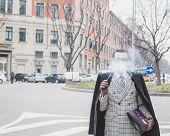 Man Outside Armani Fashion Show Building For Milan Women's Fashion Week 2015