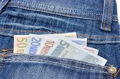 Blue jeans with euro notes in back pocket