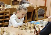 Schoolgirl Playing Chess Tournament
